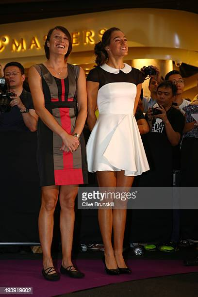 Katarina Srebotnik of Slovenia and Caroline Garcia of France attend the Official Draw Ceremony prior to the BNP Paribas WTA Finals at The Shoppes at...