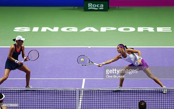 Katarina Srebotnik of Slovenia and Caroline Garcia of France in action against YungJan Chan of Chinese Taipei and HaoChing Chan of Chinese Taipei in...