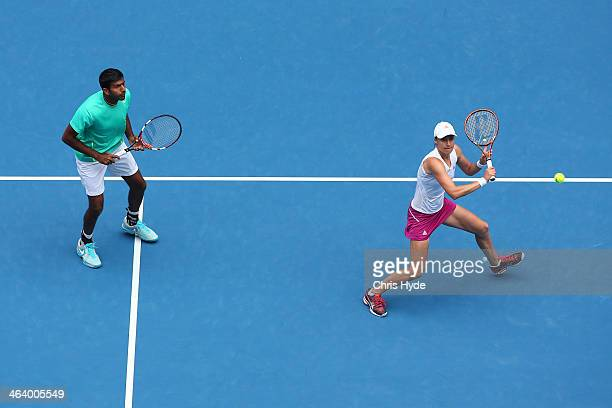 Katarina Srebotnik of Slovenia and Rohan Bopanna of India in action in their second round mixed doubles match against Ashleigh Barty of Australia and...