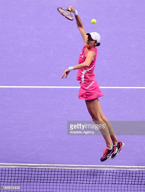 Katarina Srebotnik of Slovenia returns the ball to Hsieh SuWei of Taipei and Peng Shuai of China while playing with Nadi Petrova of Russia during the...