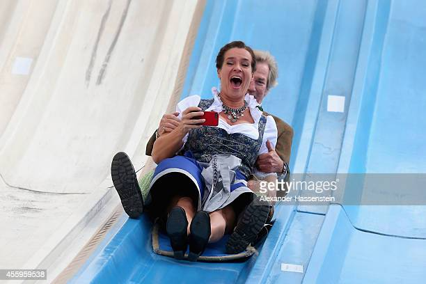 Katarina Witt attends with Prince Leopold von Bayern on a slide the 'BMW Wiesn SportStammtisch' of the 2014 Oktoberfest at Theresienhoehe on...