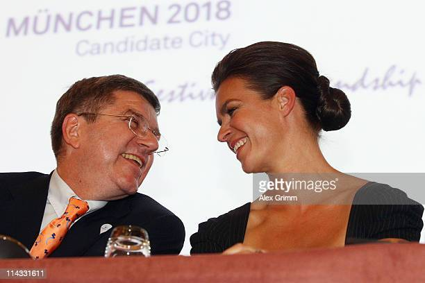 Katarina Witt Chair of Munich 2018 smiles with IOC Vice President Thomas Bach during a press conference after the briefing for IOC members at the...