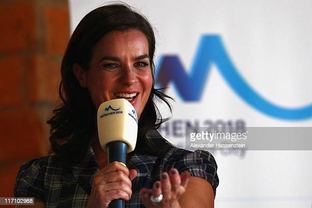 Katarina Witt Chair of Munich 2018 talks to guests during the Munich 2018 candidate city meeting on June 22 2011 in Munich Germany