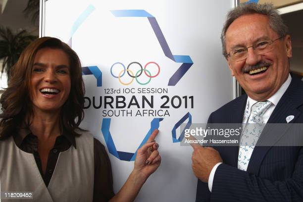Katarina Witt Chair of the Munich 2018 Bid Committee and twotime Olympic champion poses with Lord Mayor of Munich Christian Ude during a photo call...