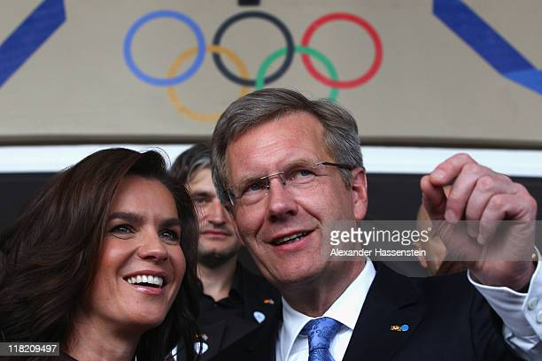 Katarina Witt Chair of the Munich 2018 Bid Committee and twotime Olympic champion talks to Germany's Head of State President Christian Wulff during a...