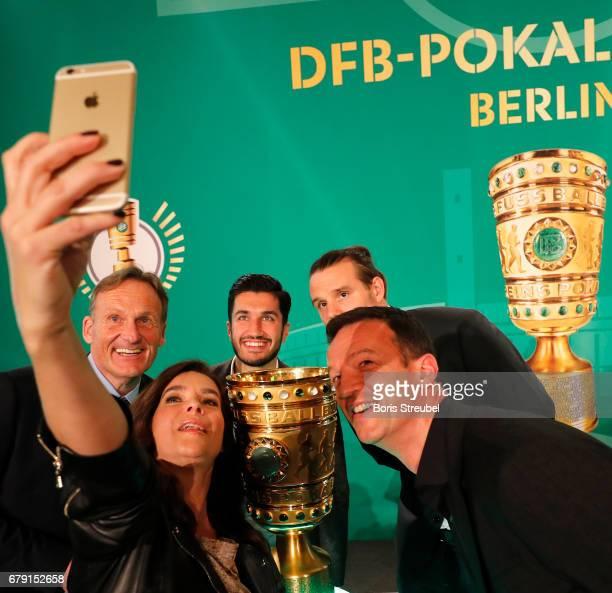 Katarina Witt takes a selfie with Hans Joachim Watzke CEO of Borussia Dortmund Nuri Sahin player of Borussia Dortmund Alexander Meier of Eintracht...