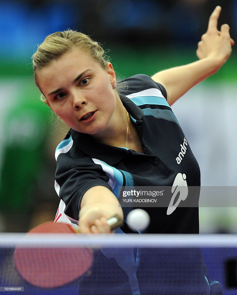 Katarzyna Grybowska of Poland returns a service to Liu Shiwen of China during their women's teams group A match at the 2010 World Team Table Tennis Championships in Moscow on May 25, 2010.