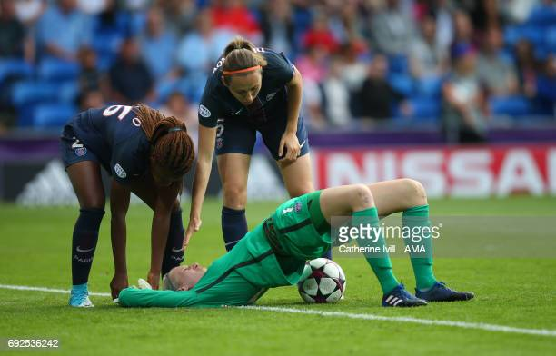 Katarzyna Kiedrzynek of PSG is checked on by her team mates as he stretches during the UEFA Women's Champions League Final match between Lyon and...
