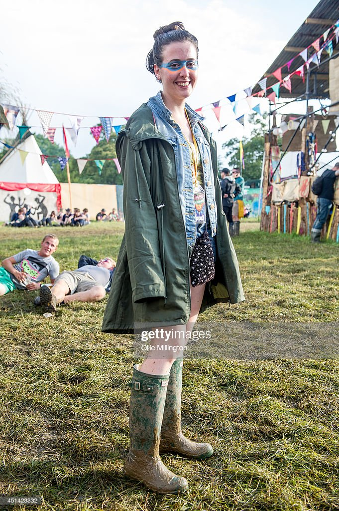 Kate ,18 ,a fashion intern from Winchester attends the Glastonbury Festival on day 2 wearing all Primark and Hunter Wellies at Worthy Farm on June 28, 2014 in Glastonbury, England.