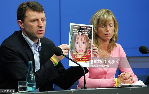 Kate and Gerry McCann the parents of the missing 4yearold British girl Madeleine McCann hold up a picture of Madeleine during a press conference on...