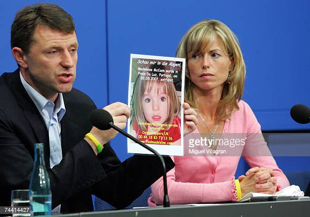 Kate and Gerry McCann the parents of the missing 4yearold British girl Madeleine McCann display a poster of their missing daughter during a press...