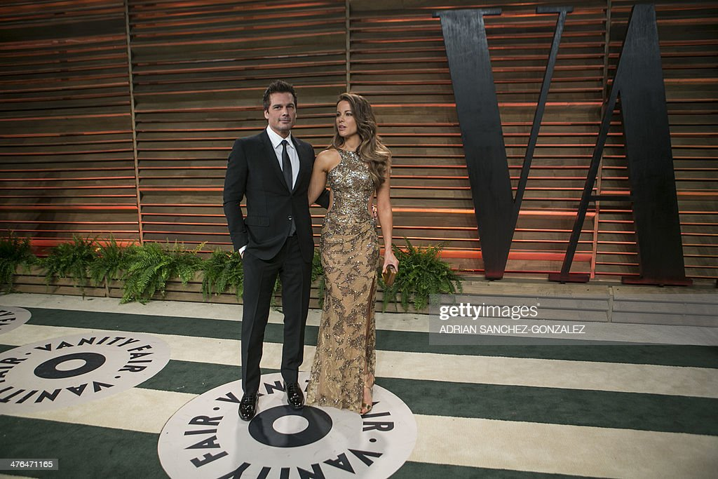 Kate Beckinsale (R) and her husband Len Wiseman arrive at the 2014 Vanity Fair Oscar Party on March 2, 2014 in West Hollywood, California. AFP PHOTO/ADRIAN SANCHEZ-GONZALEZ