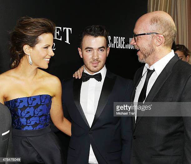 Kate Beckinsale Kevin Jonas and Paul Haggis arrive at the Hollywood Domino's 7th Annual PreOscar Charity Gala held at Sunset Tower on February 27...