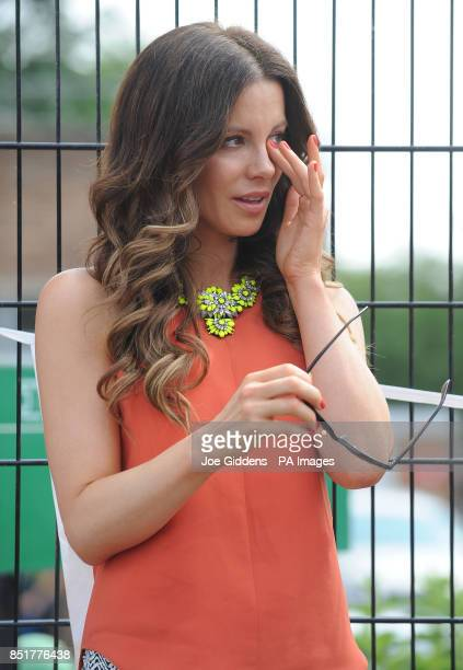 Kate Beckinsale wipes away a tear during a visit to College House Junior School after she unveiled a plaque in memory of her late father Richard...