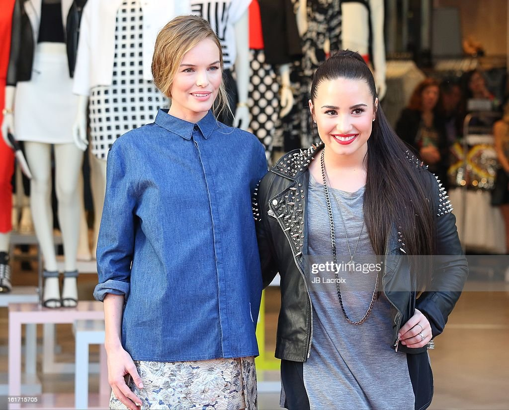 Kate Bosworth and Demi Lovato attend Topshop Topman LA Grand Opening at The Grove on February 14, 2013 in Los Angeles, California.