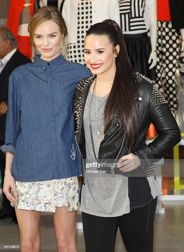 Kate Bosworth (L) and Demi Lovato attend Topshop Topman LA Grand Opening at The Grove on February 14, 2013 in Los Angeles, California.