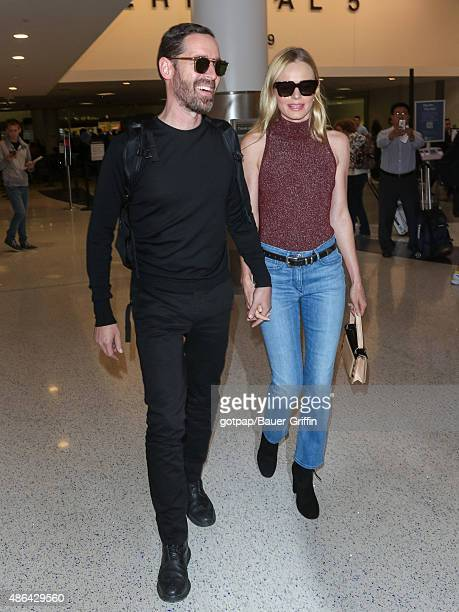 Kate Bosworth and her husband Michael Polish are seen at Los Angeles International Airport on September 03 2015 in Los Angeles California