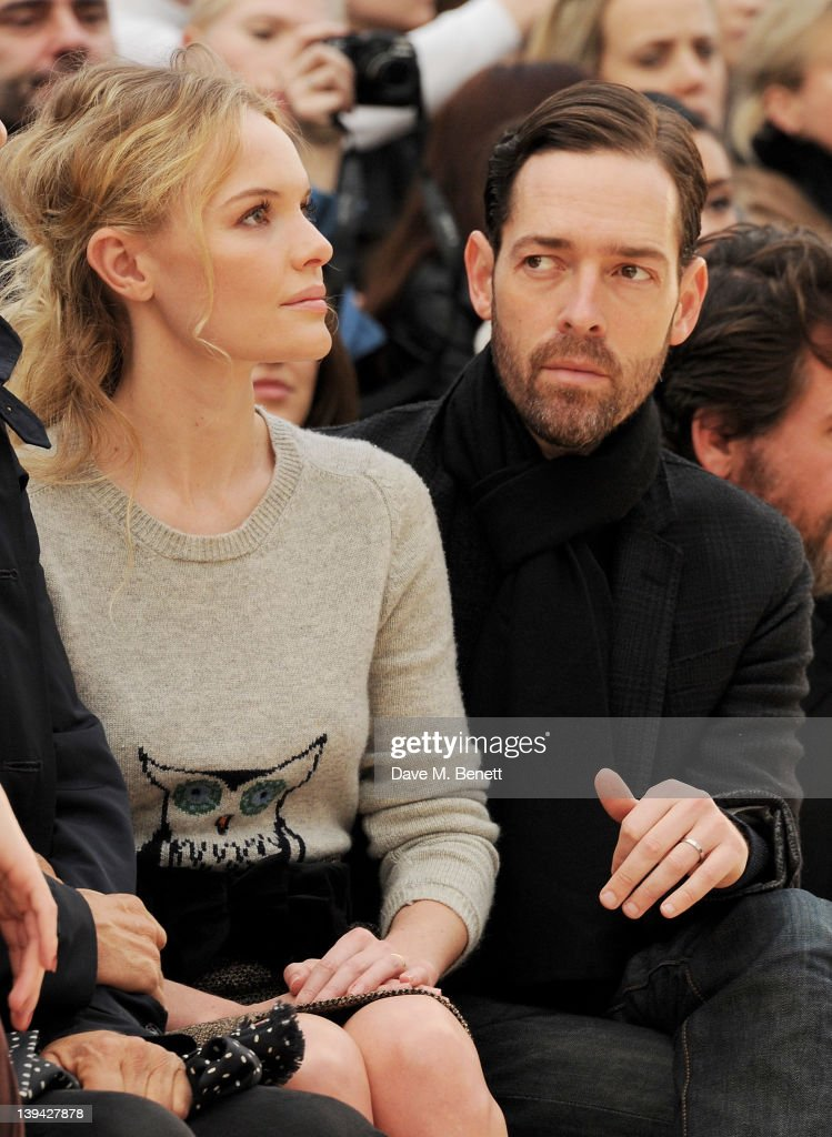 Kate Bosworth (L) and Michael Polish attend the Burberry Autumn Winter 2012 Womenswear Front Row during London Fashion Week at Kensington Gardens on February 20, 2012 in London, England.