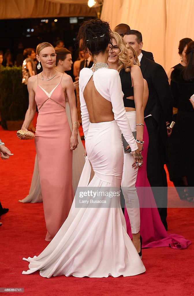 Kate Bosworth, Cara Delevigne and Rihanna attend the 'Charles James: Beyond Fashion' Costume Institute Gala at the Metropolitan Museum of Art on May 5, 2014 in New York City.