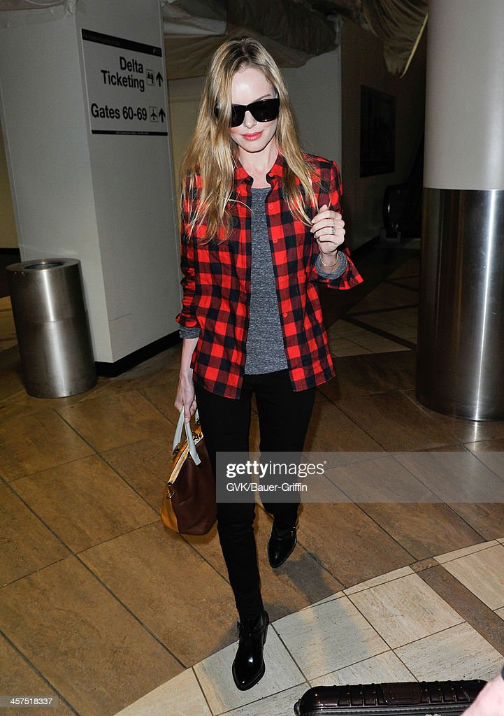 <a gi-track='captionPersonalityLinkClicked' href=/galleries/search?phrase=Kate+Bosworth&family=editorial&specificpeople=201616 ng-click='$event.stopPropagation()'>Kate Bosworth</a> is seen at Los Angeles International airport on December 17, 2013 in Los Angeles, California.