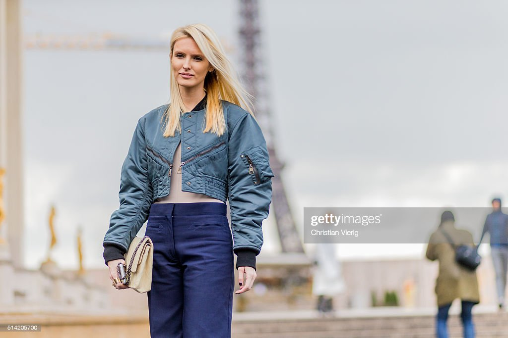 Kate Davidson Hudson wearing a bomber jacket posing in front of the Eifel Tower outside Sacai during the Paris Fashion Week Womenswear Fall/Winter...