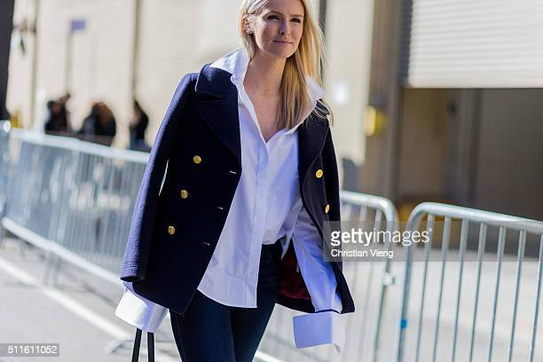 Kate Davidson Hudson wearing a navy wool jacket with golden buttons and a white button shirt seen outside Ralph Lauren during New York Fashion Week...