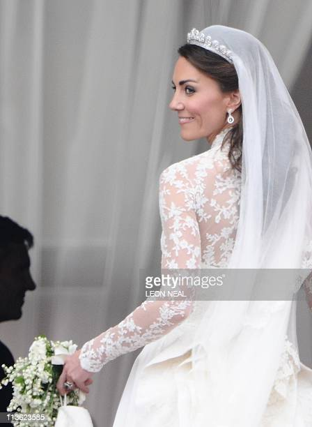 Kate Duchess of Cambridge turns back as she leaves the balcony of Buckingham Palace London after after her wedding to Britain's Prince William on...