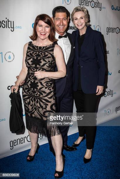 Kate Flannery Jane Lynch and Tim Davis arrive at the Montage Hotel on March 21 2017 in Beverly Hills California