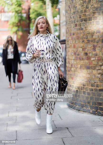 Kate Foley wearing white overall outside Anya Hindmarch during London Fashion Week September 2017 on September 17 2017 in London England