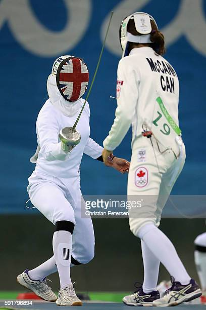 Kate French of Great Britain duels with Melanie McCann of Canada during the Modern Pentathlon Womens Fencing classification round on Day 13 of the...