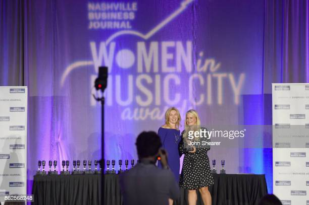 Kate Herman President and Publisher of Nashville Business Journal Women in Music City and Allison Brown Jones of Big Machine Label Group take photos...