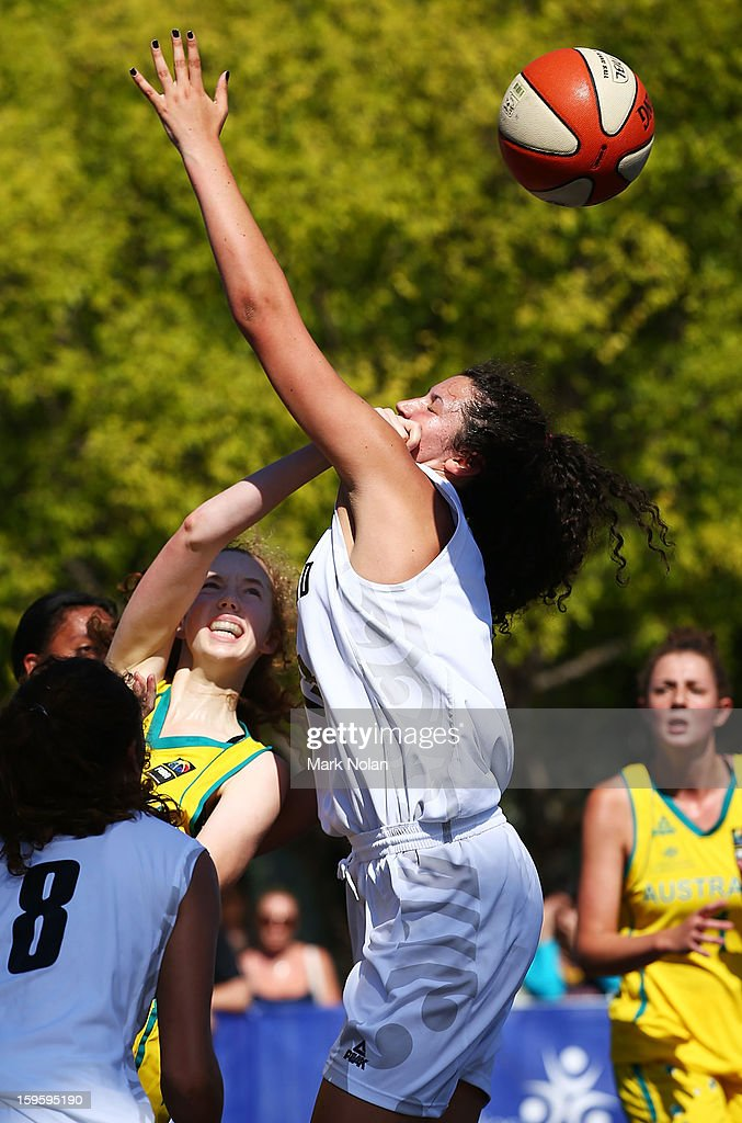 Kate Hewett of Australia Green and Jessa Boagni of New Zealand contest possession in the Womens Basketball 3x3 match between Australia Green and New Zealand during day two of the 2013 Australian Youth Olympic Festival at Darling Harbour on January 17, 2013 in Sydney, Australia.