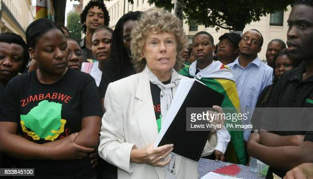 Kate Hoey MP Chair of the AllParty Parliamentary Group on Zimbabwe is given a petition by protestors at the fifth anniversary of the Zimbabwe Vigil...