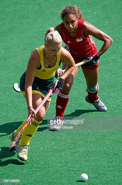 Kate Hollywood of Australia passes in front of Kerry Williams of England in the Womens Hockey Semi Final between Australia and England at the Major...