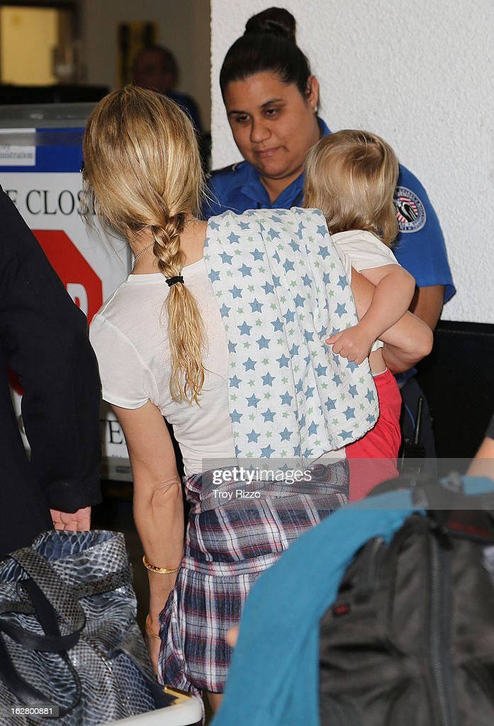 Kate Hudson and her son Bingham Hawn Bellamy are sighted at Miami International Airport on February 27, 2013 in Miami, Florida.