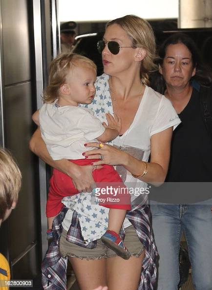Kate Hudson and her son Bingham Hawn Bellamy are sighted at Miami International Airport on February 27 2013 in Miami Florida
