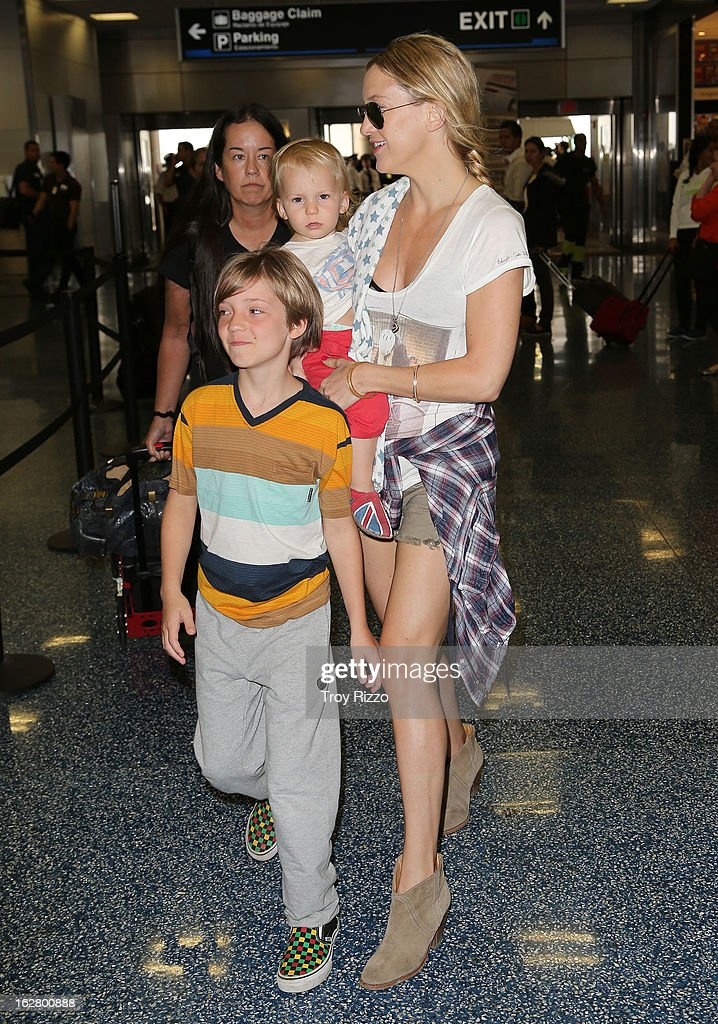 Kate Hudson, and her sons, Bingham Hawn Bellamy and Ryder Robinson are sighted at Miami International Airport on February 27, 2013 in Miami, Florida.