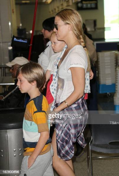 Kate Hudson and her sons Bingham Hawn Bellamy and Ryder Robinson are sighted at Miami International Airport on February 27 2013 in Miami Florida