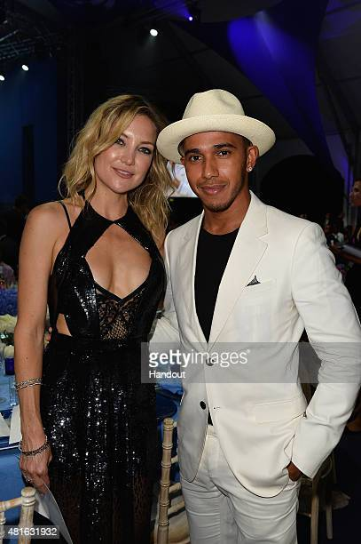 Kate Hudson and Lewis Hamilton attend a dinner during The Leonardo DiCaprio Foundation 2nd Annual SaintTropez Gala at Domaine Bertaud Belieu on July...