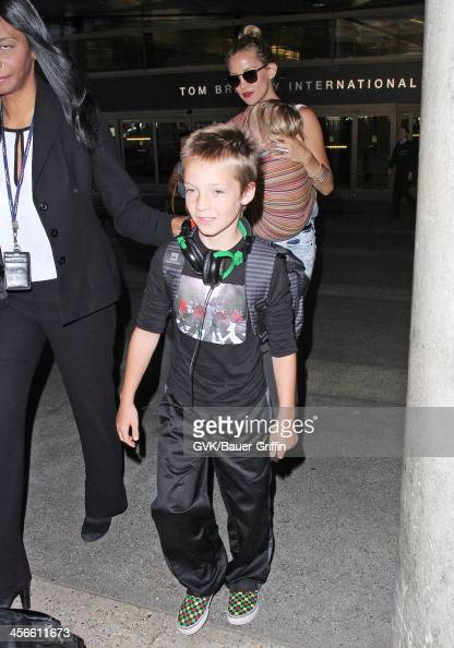 Kate Hudson is seen at Los Angeles International Airport with her sons Bingham Hawn Bellamy and Ryder Robinson on July 30 2013 in Los Angeles...
