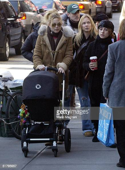 Kate Hudson walks in SoHo with her son Ryder Russell Robinson November 26 2004 in New York City