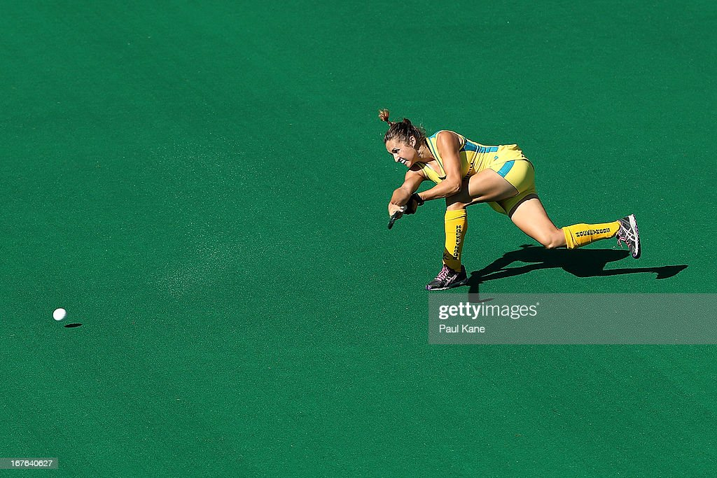 Kate Jenner of Australia passes the ball during the International Test match between the Australian Hockeyroos and Korea at Perth Hockey Stadium on April 27, 2013 in Perth, Australia.