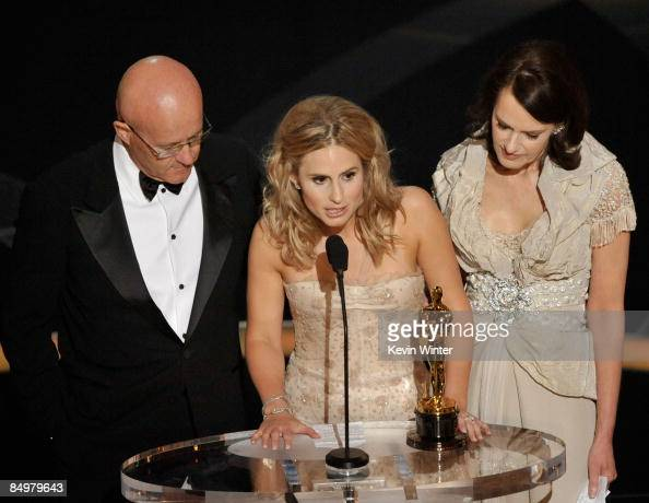 Kate Ledger sister of late Heath Ledger accepts the award for Best Supporting Actor for 'The Dark Night' with father Kim and mother Sally during the...