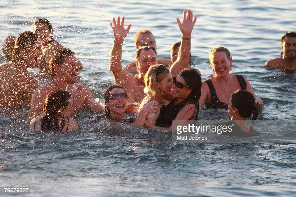 Kate Ledger with family and friends swim in the ocean outside of the Indiana Tea House at Heath Ledger's wake on February 9 2008 in Perth Australia...
