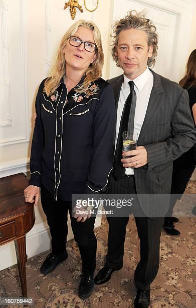 Kate Lee and Dexter Fletcher attend a drinks reception awarding Sir Alan Parker the BAFTA Fellowship supported by Hackett at The Savoy Hotel on...