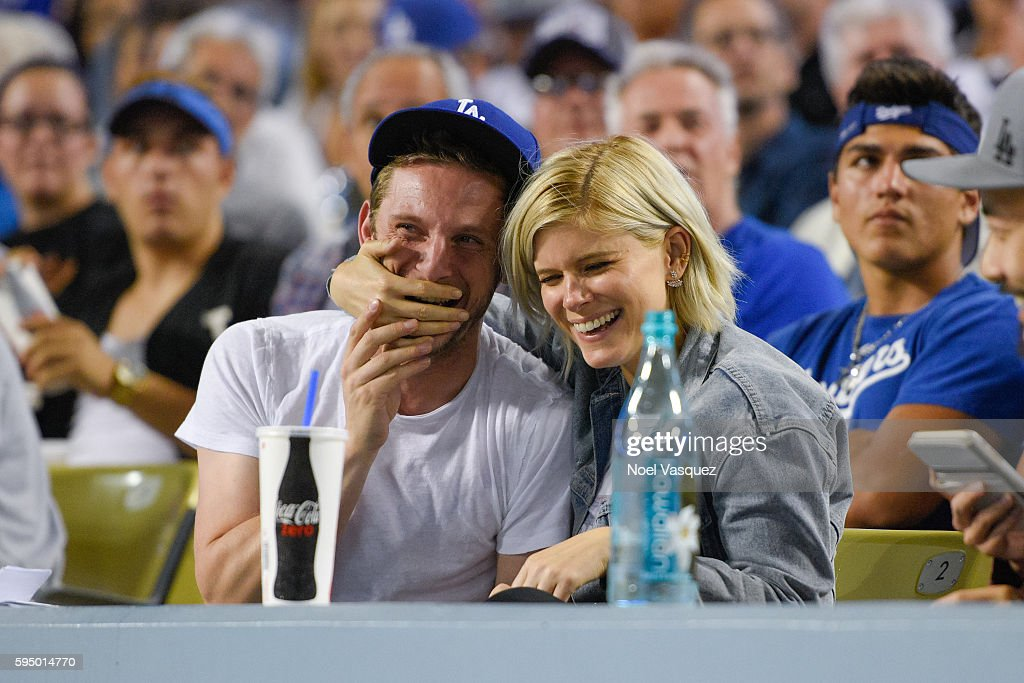 Kate Mara and Jamie Bell attend a baseball game between the San Francisco Giants and the Los Angeles Dodgers at Dodger Stadium on August 24 2016 in...