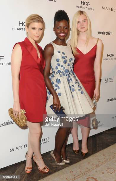 Kate Mara Lupita Nyong'o and Elle Fanning arrive at Marie Claire's Fresh Faces Party at Soho House on April 8 2014 in West Hollywood California
