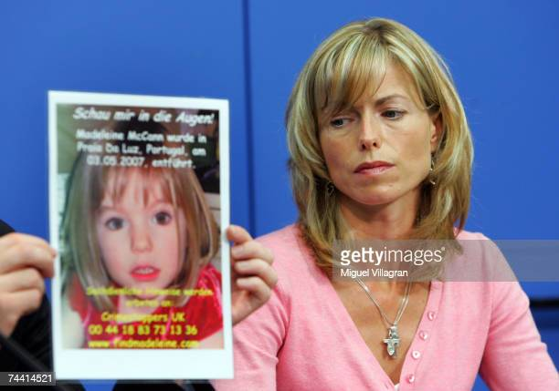 Kate Mc Cann the mother of the missing 4yearold British girl Madeleine McCann looks at a poster showing her missing daughter during a press...