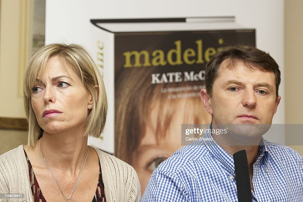 <a gi-track='captionPersonalityLinkClicked' href=/galleries/search?phrase=Kate+McCann&family=editorial&specificpeople=4278082 ng-click='$event.stopPropagation()'>Kate McCann</a> and <a gi-track='captionPersonalityLinkClicked' href=/galleries/search?phrase=Gerry+McCann&family=editorial&specificpeople=4278561 ng-click='$event.stopPropagation()'>Gerry McCann</a> listen during the launch of <a gi-track='captionPersonalityLinkClicked' href=/galleries/search?phrase=Kate+McCann&family=editorial&specificpeople=4278082 ng-click='$event.stopPropagation()'>Kate McCann</a>'s book 'Madeleine' at the Wellington Hotel on October 19, 2011 in Madrid, Spain. Kate and <a gi-track='captionPersonalityLinkClicked' href=/galleries/search?phrase=Gerry+McCann&family=editorial&specificpeople=4278561 ng-click='$event.stopPropagation()'>Gerry McCann</a>'s daughter Madeleine has been missing since the evening of May 3, 2007 while the family were on holiday in Portugal.