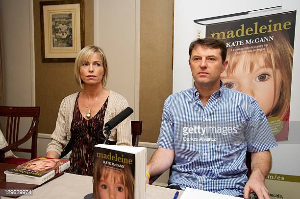 Kate McCann and Gerry McCann listen during the launch of Kate McCann's book 'Madeleine' at the Wellington Hotel on October 19 2011 in Madrid Spain...